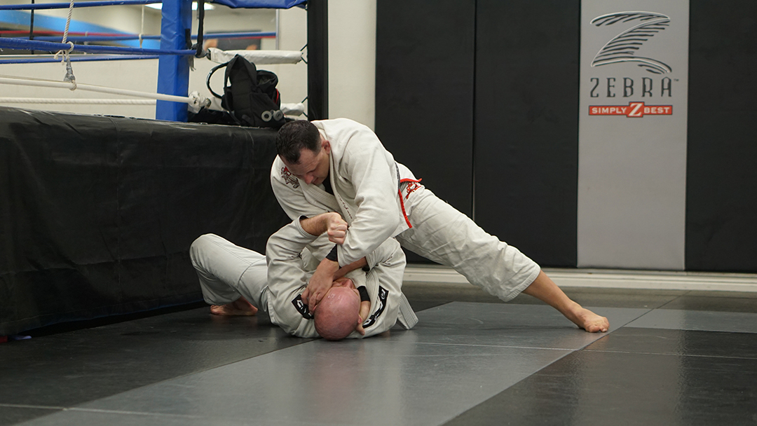 Me knee on stomach cross choke